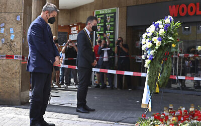 Bavaria's governor Markus Soeder, left, and the mayor of Wuerzburg, Christian Schuchardt, attend a memorial service for the victims of a brutal knife attack that left three women dead, in Wuerzburg, Germany, June 27, 2021. (Karl-Josef Hildenbrand/dpa via AP)