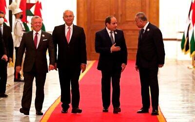From left to right, Jordan's King Abdullah II, Iraqi President Barham Salih, Egyptian President Abdel Fattah el-Sissi, and Iraqi Prime Minister Mustafa al-Kadhimi, prepare to meet in the presidential palace in Baghdad, Iraq, June 27, 2021. (AP Photo/Khalid Mohammed)