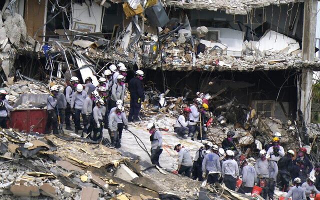 Rescue workers search in the rubble at the Champlain Towers South condominium, Monday, June 28, 2021, in the Surfside area of Miami. (AP/Lynne Sladky)