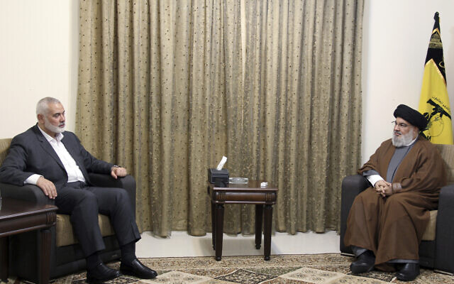 This picture released by the Hezbollah Media Relations Office, shows terror leader Sayyed Hassan Nasrallah, right, meeting with Ismail Haniyeh, the leader of the Palestinian terror group Hamas, in Beirut, Lebanon, June 29, 2021. (Hezbollah Media Relations Office, via AP )