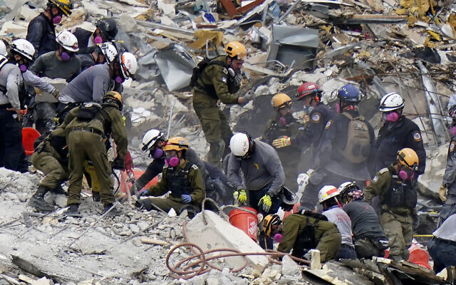 Crews from the United States and Israel work in the rubble of Champlain Towers South condo, in Surfside, Florida, June 29, 2021. (Lynne Sladky/AP)