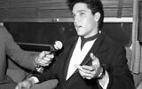 Singer Elvis Presley gestures during a press conference inside his private railroad car at Los Angeles Union Station, California, United States as he arrived on April 20, 1960 to make a movie. (AP Photo/HPM)