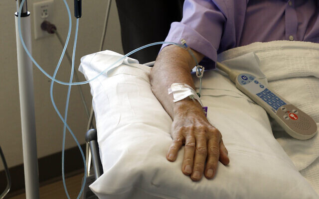 Chemotherapy is administered to a cancer patient. (AP Photo/Gerry Broome)
