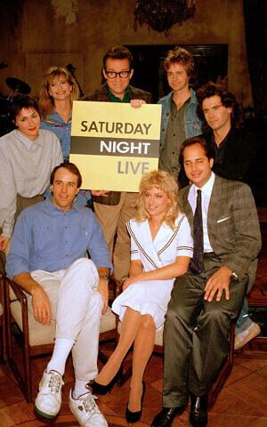 Jon Lovitz, bottom right, and the 1986 cast of NBC's 'Saturday Night Live.' Clockwise, from left: Nora Dunn, Jan Hooks, Phil Hartman, Dana Carvey, Dennis Miller, Victoria Jackson, and Kevin Nealon, December 9, 1986. (AP Photo/Richard Drew)