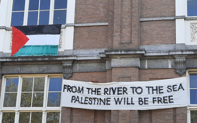 A banner about Israel hangs on the facade of the De Ateliers arts institution in Amsterdam, May 28, 2021. (Barry Mehler)
