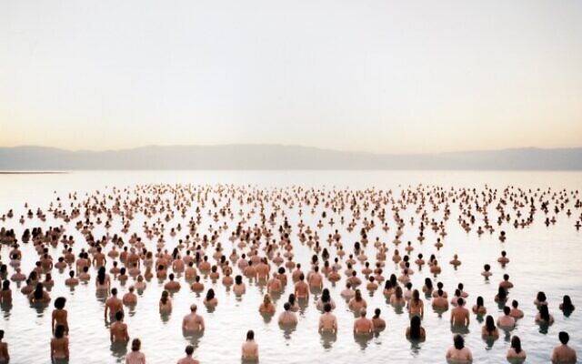 Photographer Spencer Tunick photographed 1,200 naked participants in the Dead Sea in 2011 to raise awareness of the shrinking salty waters, and will return in October 2021 to photograph a new installation (Courtesy Spencer Tunick)