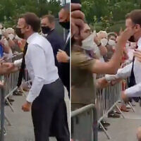 French President Emmanuel Macron is slapped in the face by a man during a visit in a small town of southeastern France, June 8, 2021. (Screen capture: Twitter)