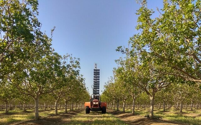 Edete Precision Technologies for Agriculture's automated pollination machines among pistachio trees (Courtesy)