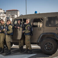 Illustrative: Female soldiers of the Military Police Erez Battalion at a checkpoint near Jerusalem, on December 22, 2015. (Hadas Parush/Flash90)