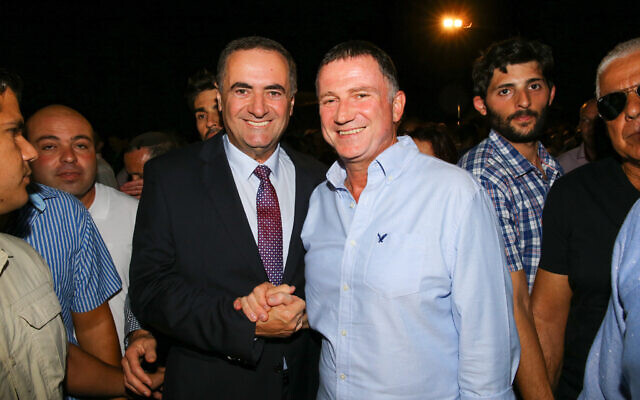 Transportation Minister Israel Katz (L) with Knesset Chairman Yuli Edelstein, October 18, 2016, during the Jewish holiday of Sukkot. (Flash90)