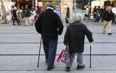 An elderly couple walking on Jaffa street in central Jerusalem on February 20, 2017. (Nati Shohat/Flash90)