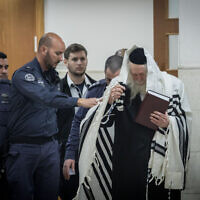 Rabbi Eliezer Berland arrives for a hearing  at the Jerusalem District court on February 28, 2020. (Yonatan Sindel/Flash90)