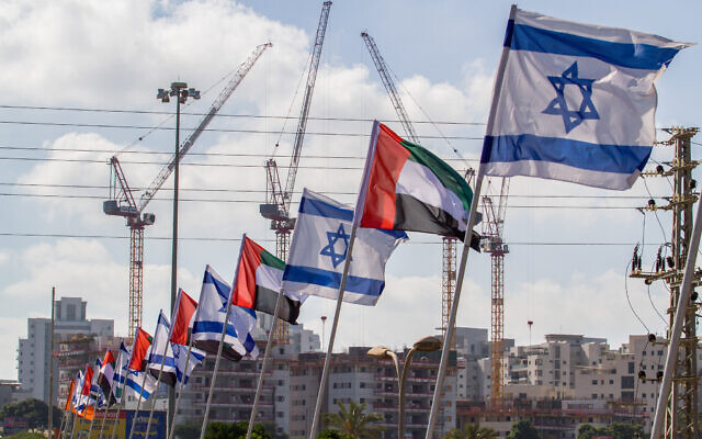 The Israeli and United Arab Emirates flags seen on the side of a road in the city of Netanya, August 16, 2020. (Flash90)