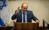 Yamina leader Naftali Bennett speaks from the rostrum in the Knesset plenum on August 24, 2020. (Oren Ben Hakoon/Pool/Flash90)