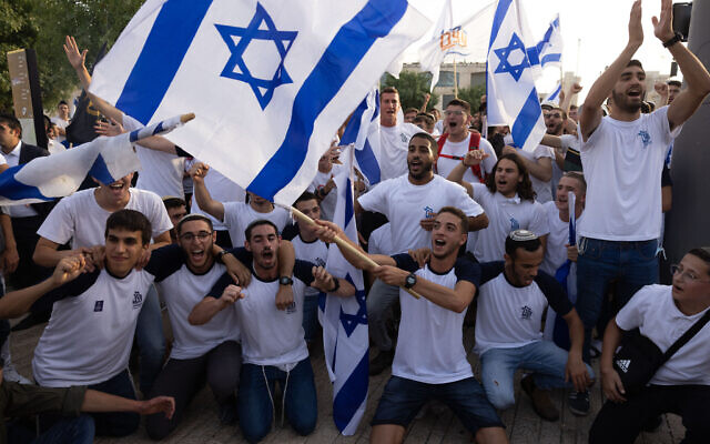 Israelis wave national flags during a Jerusalem Day march, in Jerusalem, May 10, 2021. (Nati Shohat/Flash90)