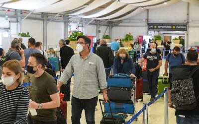 Medical technicians test passengers for COVID-19 at the Ben Gurion International Airport on March 8, 2021. (Flash90)