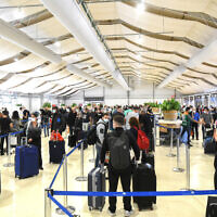 Illustrative: People wait in line to be tested for COVID-19 at Ben Gurion International Airport on March 8, 2021. (Flash90)