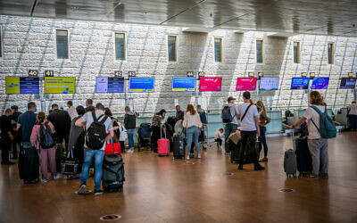 Travelers in the departures hall at Ben Gurion Airport on April 18, 2021. (Yossi Aloni/Flash90)
