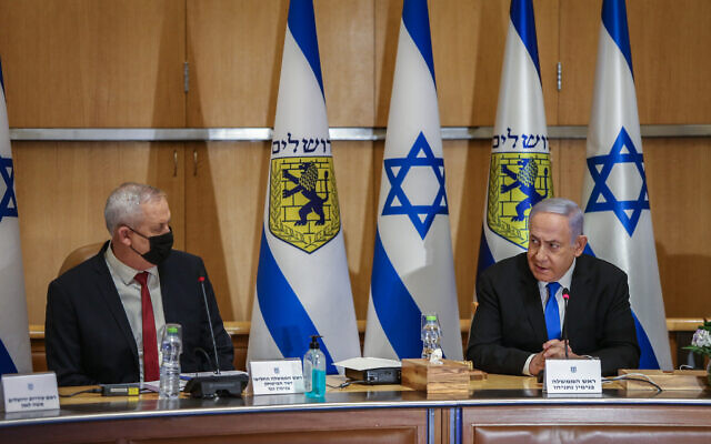 Prime Minister Benjamin Netanyahu and Alternate Prime Minister and Minister of Defense Benny Gantz at the weekly cabinet meeting, at the Jerusalem City Hall in Jerusalem on May 9, 2021. (Amit Shabi/POOL)