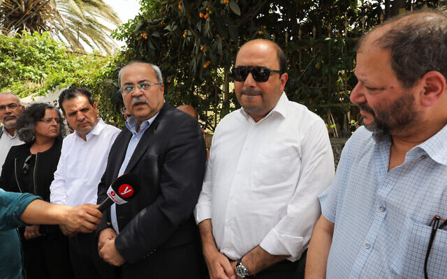 Joint List MKs (from L) , Aida Touma-Suleiman, Ayman Oudeh, Ahmad Tibi, Sami Abou Shahadeh, and Ofer Cassif visit the East Jerusalem neighborhood of Sheikh Jarrah on May 10, 2021. (Olivier Fitoussi/Flash90)