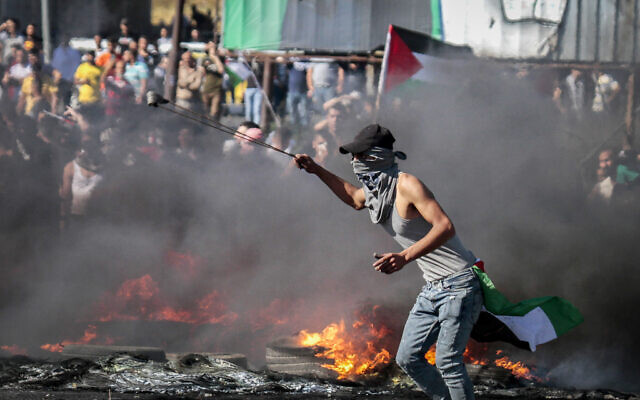 Illustrative: Palestinian protesters clash with Israeli security forces near the Hawara checkpoint, south of the West Bank city of Nablus May 18, 2021.  (Nasser Ishtayeh/Flash90)