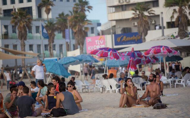 Israelis enjoy the beach in Tel Aviv on May 22, 2021. (Miriam Alster/FLASH90)