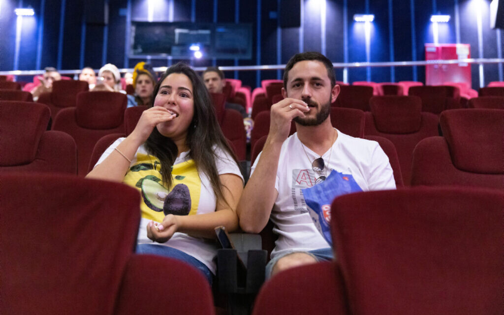 Delighted that cinemas have reopened, Israelis watch a movie in Jerusalem, May 27, 2021. (Olivier Fitoussi/Flash90)
