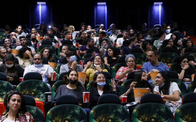 Israelis attend a movie at the Cinema City theatre in Jerusalem on May 27, 2021. (Olivier Fitoussi/Flash90)