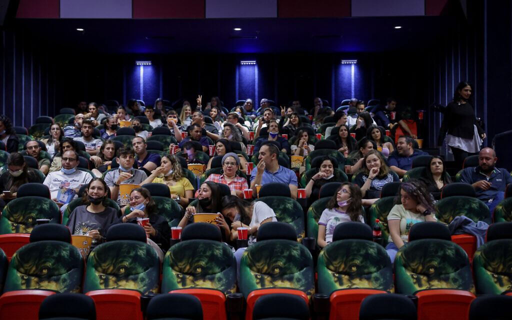 Israelis attend a movie at Jerusalem's Cinema City movie theatre on May 27, 2021, the official reopening night after14 months of closure during the coronavirus pandemic (Olivier Fitoussi/Flash90)