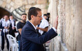 Isaac Herzog prays at the Western Wall in Jerusalem's Old City on June 1, 2021, a day before he was selected by Knesset members as Israel's 11th president. (Olivier Fitoussi/Flash90)