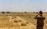 IDF bulldozers work on the Israeli-Gaza border, east of Khan Yunis, in southern Gaza Strip, on June 2, 2021. (Abed Rahim Khatib/Flash90)