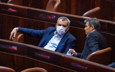 New Hope MK Zeev Elkin (L) seen in the plenum hall of the Israeli parliament during the voting in the presidential elections, in Jerusalem, June 2, 2021. (Olivier Fitoussi/ Flash90)