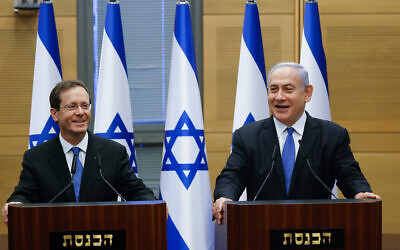 Newly elected Israeli President Isaac Herzog (left) with Prime Minister Benjamin Netanyahu in the Knesset after Herzog's election, June 2, 2021. (Yonatan Sindel/Flash90)