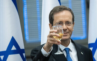 Isaac Herzog raises a toast at the Knesset after he was elected by lawmakers as Israel's 11th president, June 2, 2021. (Yonatan Sindel/Flash90)