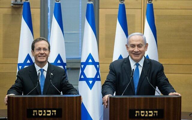 President-elect Isaac Herzog with Prime Minister Benjamin Netanyahu in the Knesset after Herzog's election, June 2, 2021. (Yonatan Sindel/Flash90)