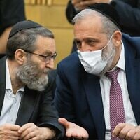 "UTJ leader Moshe Gafni (left) and Shas leader Aryeh Deri at a press conference at the Knesset, June 8, 2021, denouncing Prime Minister-designate Naftali Bennett and his ""change government"" colleagues.  (Yonatan Sindel/Flash90)"