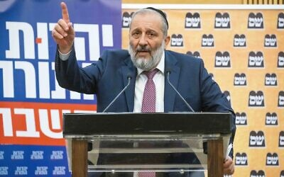 Shas head Aryeh Deri gives a press statement (together with UTJ MK Moshe Gafni and Yaakov Litzman) at the Knesset, June 8, 2021. (Yonatan Sindel/Flash90)