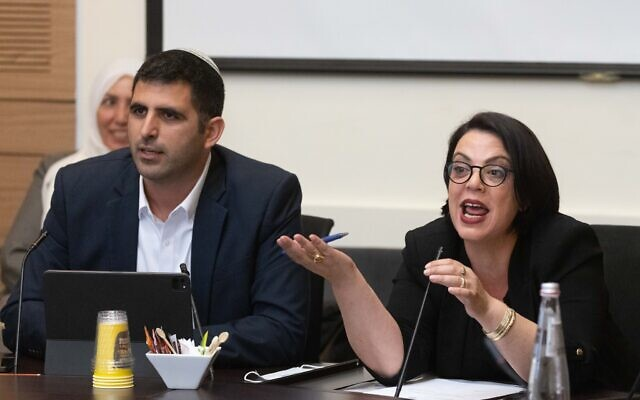 Likud MKs Shlomo Karhi (L) and Galit Distel attend a meeting of the Arrangements Committee at the Knesset, in Jerusalem, on June 9, 2021. (Olivier Fitoussi/Flash90)