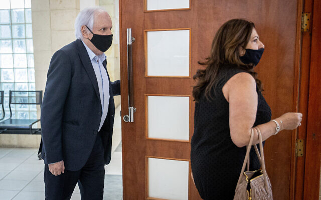 Shaul and Iris Elovitch arrive at the Jerusalem District Court on June 9, 2021. (Yonatan Sindel/Flash90)