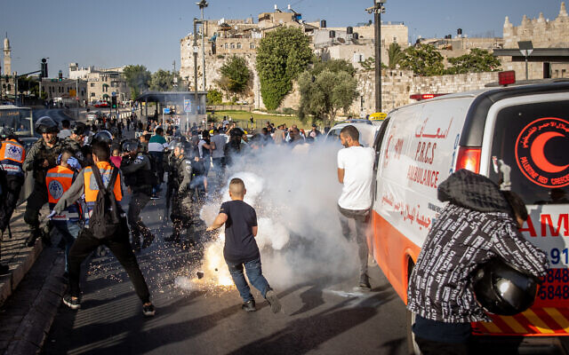 Police seen during clashes with protesters following a visit of right-wing Religious Zionism party lawmaker MK Itamar Ben Gvir at the Damascus Gate of the Old City of Jerusalem, on June 10, 2021.  (Yonatan Sindel/Flash90)