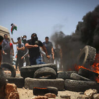 Palestinian protesters in the village of Beita village near the West Bank city of Nablus, June 11, 2021 (Flash90)
