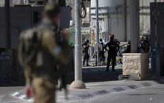 Israeli security forces guard after a Palestinian woman was shot, at the Qalandiya Checkpoint near Jerusalem, June 12, 2021. (Jamal Awad/Flash90)