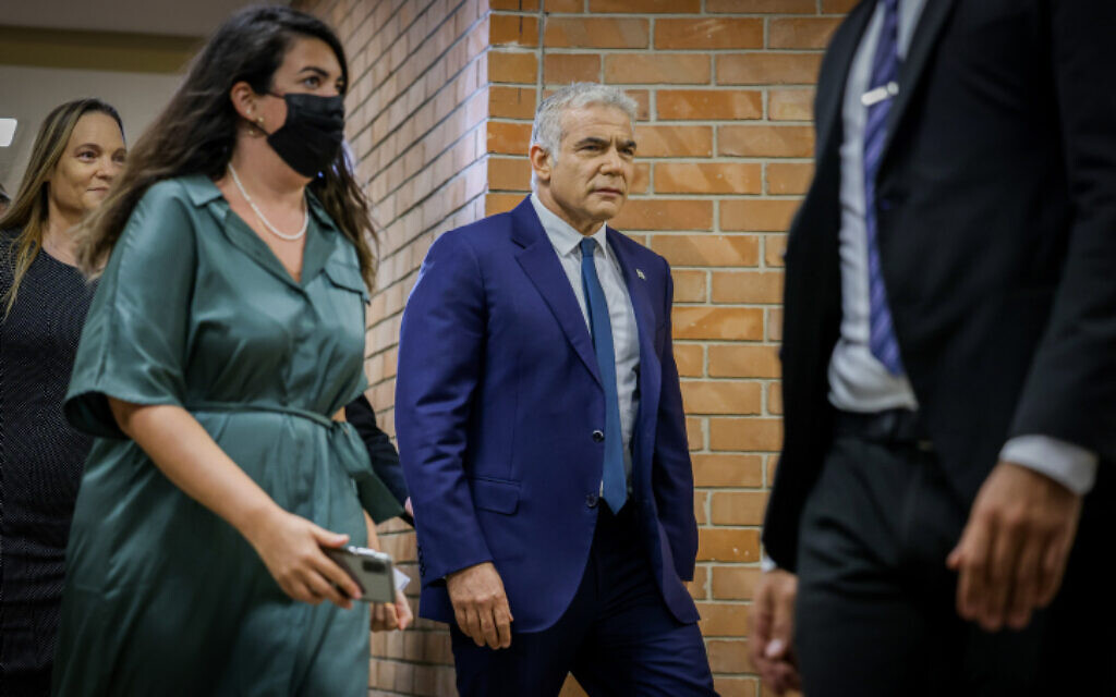 Head of the Yesh Atid party Yair Lapid arrives for a meeting with heads of the prospective unity government at the Knesset in Jerusalem, on June 13, 2021 (Olivier Fitoussi/Flash90)
