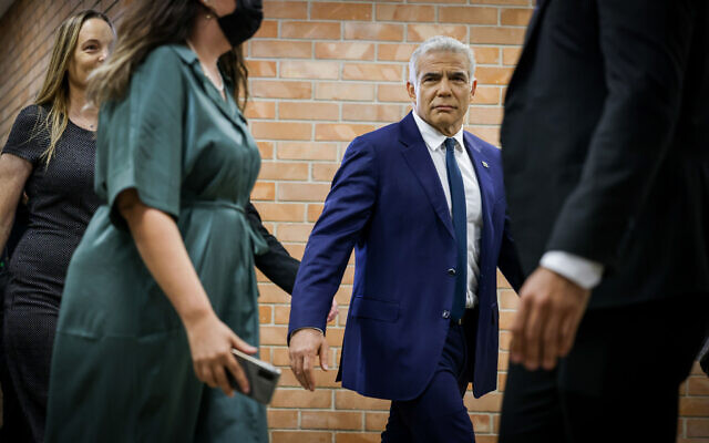 Yair Lapid arrives for a meeting with heads of the unity government at the Knesset on June 13, 2021. (Olivier Fitoussi/Flash90)