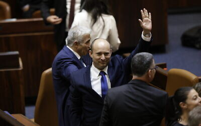Israel's new Prime Minister Naftali Bennett (C) after the swearing in of the new government, in the Knesset on June 13, 2021. (Olivier Fitoussi/FLASH90)