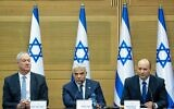 Prime Minister Naftali Bennett (R), Foreign Minister Yair Lapid (C) and Defense Minister Benny Gantz attend the first cabinet meeting, at the Israeli parliament on June 13, 2021. (Yonatan Sindel/Flash90)