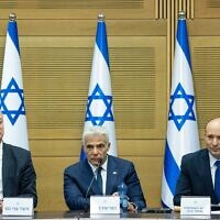 Prime Minister Naftali Bennett (R), Foreign Minister Yair Lapid (C) and Defense Minister Benny Gantz attend the first cabinet meeting, at the Knesset on June 13, 2021. (Yonatan Sindel/Flash90)
