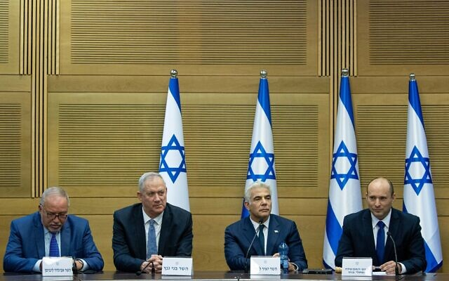 From right, Prime Minister Naftali Bennett, Foreign Minister Yair Lapid, Defense Minister Benny Gantz and Finance Minister Avigdor Liberman attend the first cabinet meeting, at the Knesset on June 13, 2021. (Yonatan Sindel/Flash90)