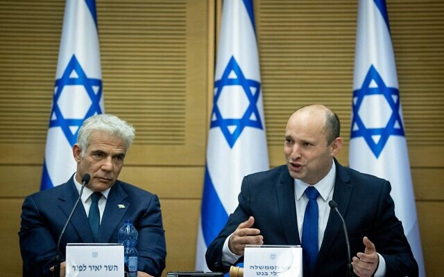 Israeli Prime Minister Naftali Bennett and Israeli Foreign minister Yair Lapid attend the first government conference, at the Israeli parliament on June 13, 2021. (Photo by Yonatan Sindel/Flash90)