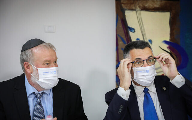 Attorney General Avichai Mandelblit with Gideon Sa'ar at a ceremony in Jerusalem, on June 14, 2021. (Olivier Fitoussi/Flash90)